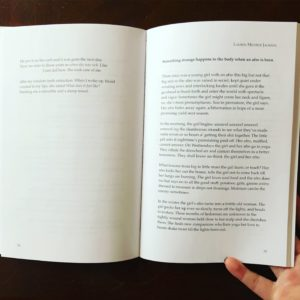 photo of an open book with the poem to the right